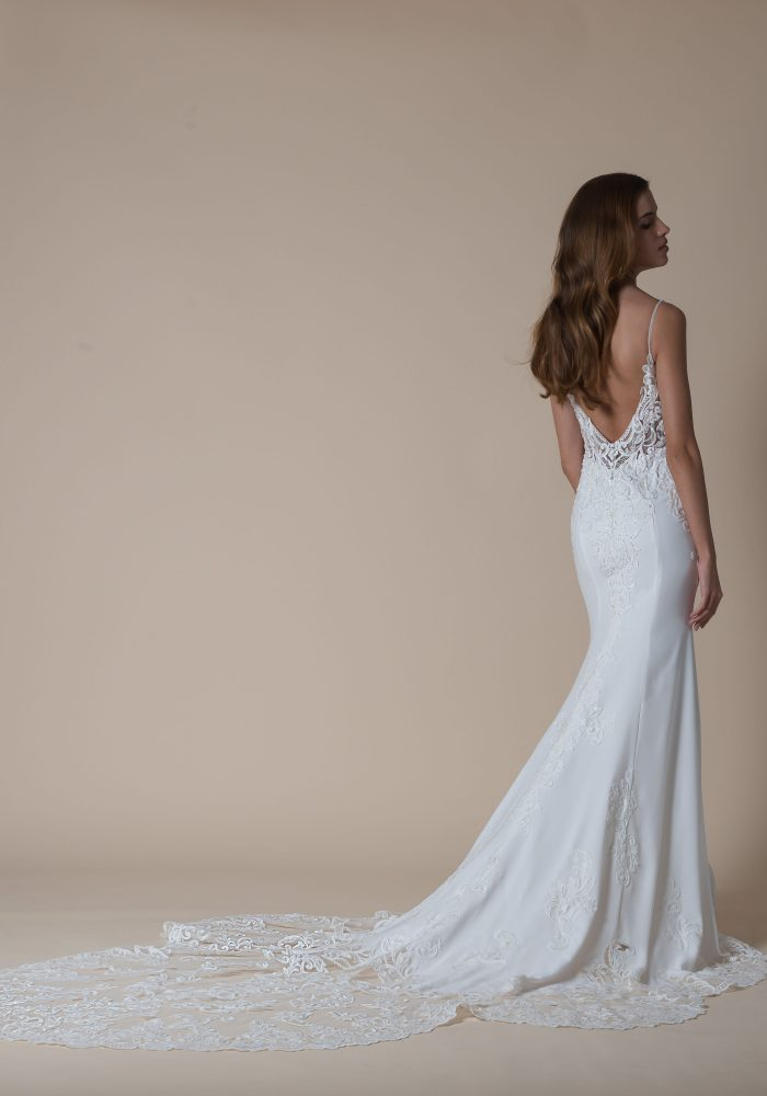 Fishtail wedding dress with lace train.