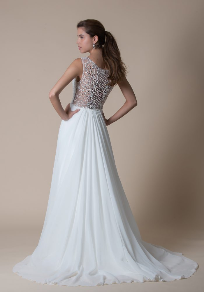 wedding dress with beaded bodice and pleated skirt